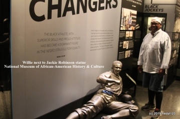 Willie posing by Jackie Robinson exhibit