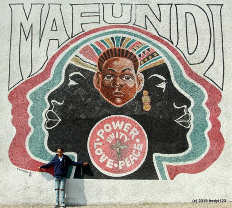 Terrell at the famous Mafundi Institute mural on 103rd St. & Wilmington