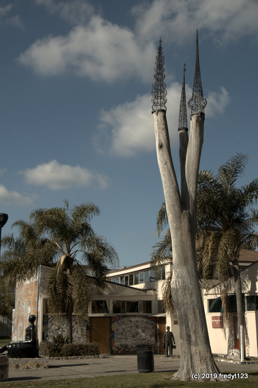 A Mingus creation - symbol of Watts Towers atop large trees