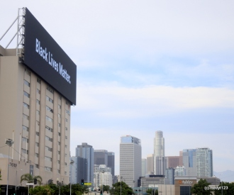 Large BLM sign with DTLA in foreground