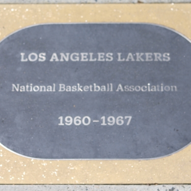 Historical markers from Los Angeles Memorial Sports Arena timeline on north side of Banc of California Stadium
